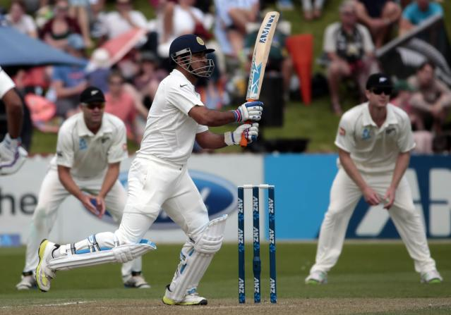 India's MS Dhoni plays a shot against New Zealand during the first innings on day two of the second international test cricket match at the Basin Reserve in Wellington, February 15, 2014. REUTERS/Anthony Phelps (NEW ZEALAND - Tags: SPORT CRICKET)