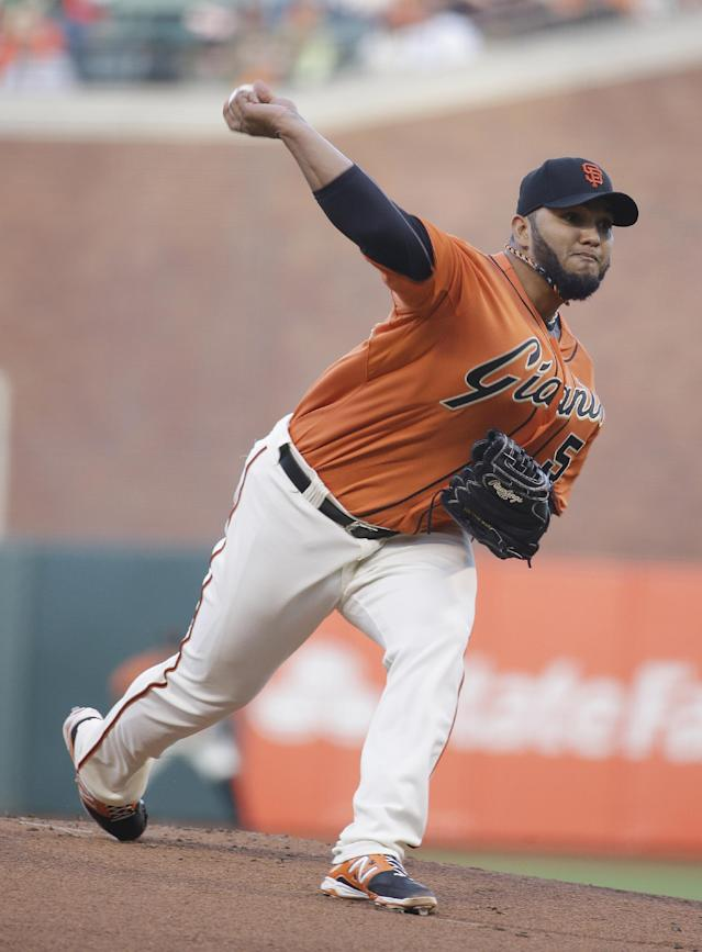 San Francisco Giants starting pitcher Yusmeiro Petit throws against the Miami Marlins in the first inning of a baseball game Friday, May 16, 2014, in San Francisco. (AP Photo/Eric Risberg)