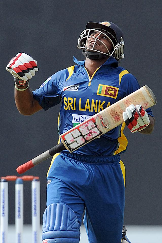 Sri Lankan cricketer Kushal Janith Perera celebrates his half-century (50 runs) during the third and final one-day international (ODI) match between Sri Lanka and Bangladesh at The  Pallekele International Cricket Stadium in Pallekele on March 28, 2013. AFP PHOTO/ Ishara S. KODIKARA        (Photo credit should read Ishara S.KODIKARA/AFP/Getty Images)