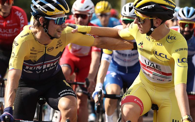 Primoz Roglic (left) greets Tadej Pogacar ahead of the official start to today's stage - GETTY IMAGES