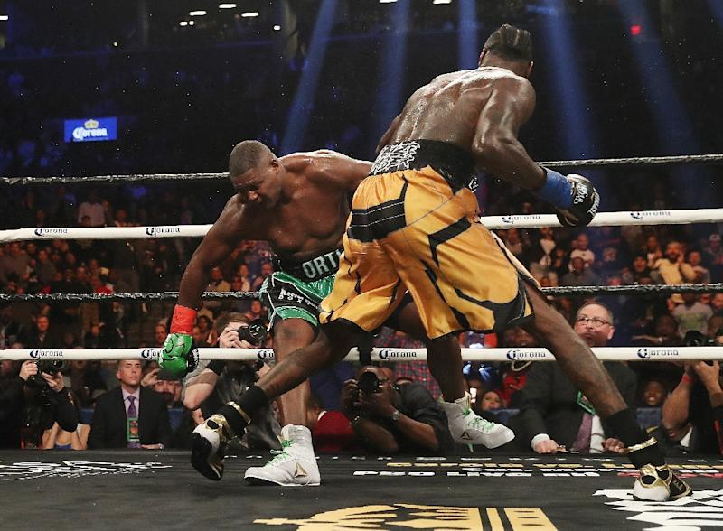 5970bf1c6306 Deontay Wilder (R) knocked down Luis Ortiz three times in the fight,  finishing