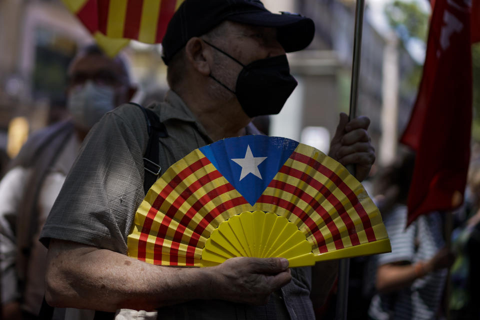 A pro-independence demonstrator attends a protest against Spain's prime minister Pedro Sanchez outside the Gran Teatre del Liceu in Barcelona, Spain, Monday, June 21, 2021. Sanchez's said Monday that the Spanish Cabinet will approve pardons for nine separatist Catalan politicians and activists imprisoned for their roles in the 2017 push to break away from Spain. (AP Photo/Joan Mateu)