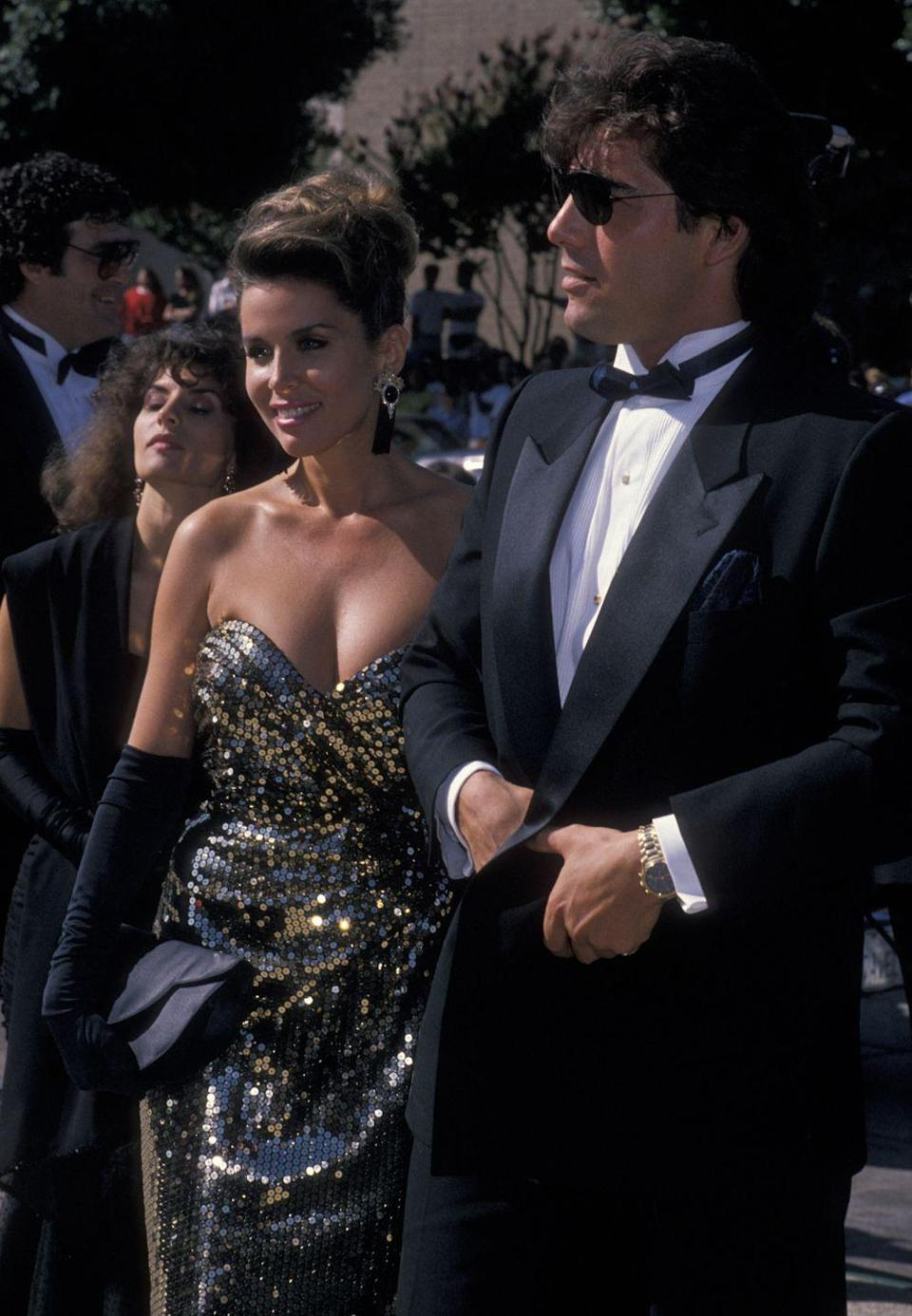 <p>This couple clearly knows how to shine in any room—especially with a little help from a gold sequined gown.</p>