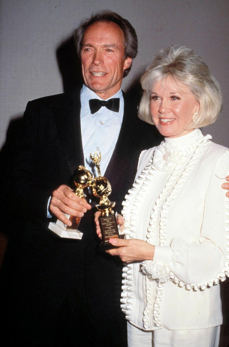 ***FILE PHOTO*** Doris Day has passed Away - 1922-2019. Clint Eastwood and Doris Day at the 1989 Golden Globe Awards Credit: 1688499Globe Photos/MediaPunch /IPX
