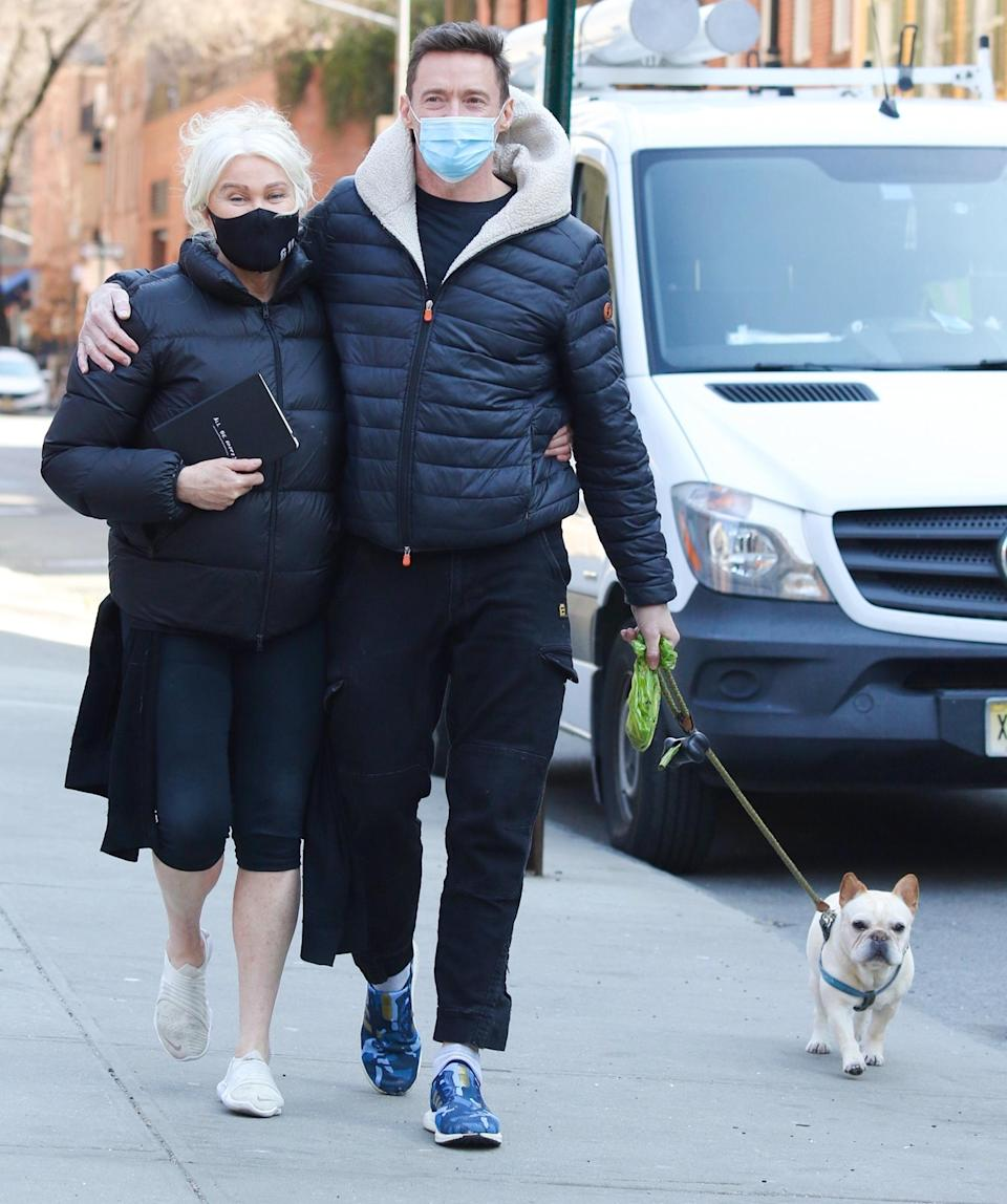 <p>Hugh Jackman, Deborra-Lee Furness and pup Dali go on a family walk through downtown N.Y.C. on Wednesday.</p>