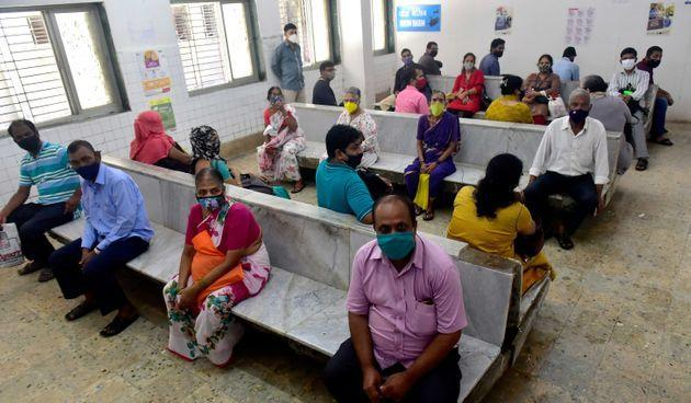 MUMBAI, INDIA  JUNE 22: Beneficiaries who need to travel abroad for educational, employment purpose and Tokyo Olympics wait in the designated area to get inoculated against Covid-19 at Pandit Madan Mohan Malviya Shatabdi Municipal General Hospital, Govandi, on June 22, 2021 in Mumbai, India. (Photo by Anshuman Poyrekar/Hindustan Times via Getty Images) (Photo: Hindustan Times via Hindustan Times via Getty Images)