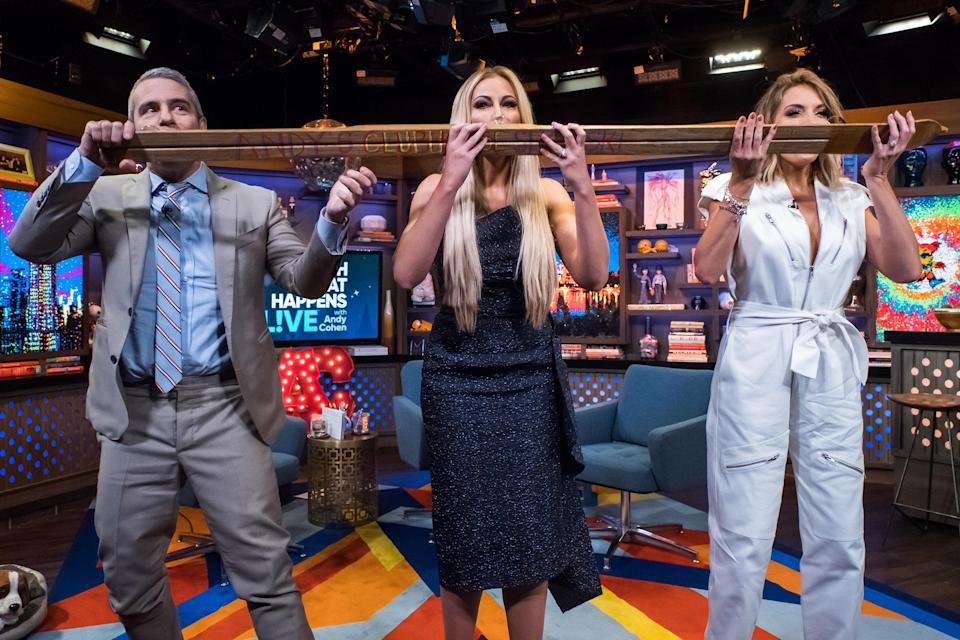 """""""Real Housewives of Dallas"""" star Stephanie Hollman (center) appears on a recent episode of 'Watch What Happens Live With Andy Cohen."""" (Photo by: Charles Sykes/Bravo/NBCU Photo Bank)"""