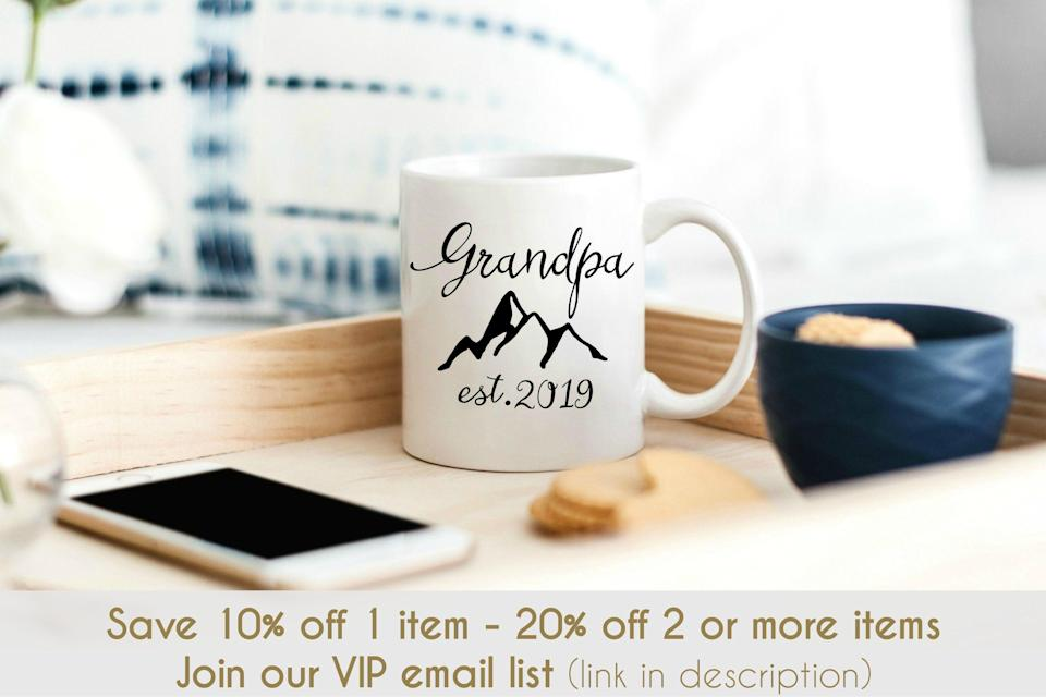 """<p><strong>Happy Gift Market</strong></p><p>etsy.com</p><p><strong>$30.58</strong></p><p><a href=""""https://go.redirectingat.com?id=74968X1596630&url=https%3A%2F%2Fwww.etsy.com%2Flisting%2F678980217%2Fpersonalized-grandpa-mug-grandpa-est&sref=https%3A%2F%2Fwww.goodhousekeeping.com%2Fholidays%2Ffathers-day%2Fg21205637%2Ffathers-day-gifts-for-grandpa%2F"""" rel=""""nofollow noopener"""" target=""""_blank"""" data-ylk=""""slk:Shop Now"""" class=""""link rapid-noclick-resp"""">Shop Now</a></p><p>If he's celebrating this year's Father's Day as a first-time grandpa, you can have the Etsy seller add in this year (or any other year) onto the mug so he forever remembers the moment he stepped up as a grandfather.</p>"""