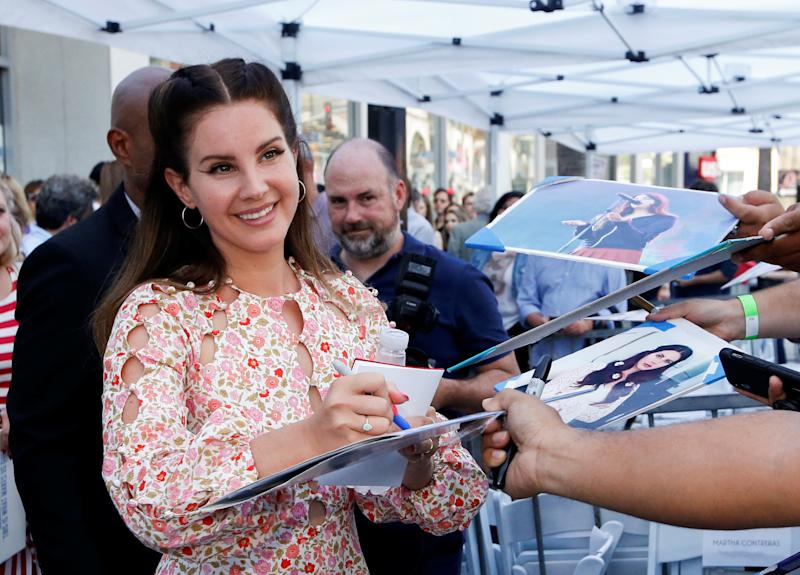 Singer Lana del Rey signs autographs during a ceremony to honor Mexican director Guillermo del Toro with a star on the Hollywood Walk of Fame in Los Angeles, California, U.S., August 6, 2019. REUTERS/Mario Anzuoni