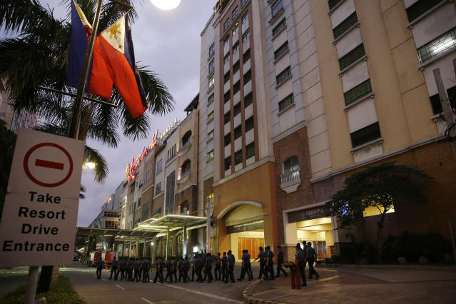 <p>Police walk outside a hotel at the Resorts World Manila complex, early Friday, June 2, 2017, in Manila, Philippines. (Photo: Aaron Favila/AP) </p>