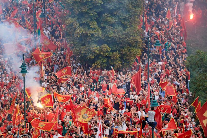 Thousands of Montenegrin nationalists loyal to President Milo Djukanovic gather in the royal city of Cetinje outside the Cetinje Monastery on September 3. Source: Getty