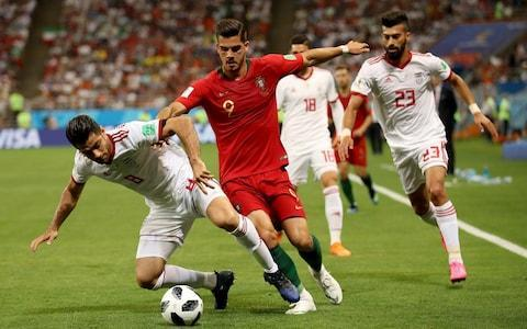 Spain vs Morocco, live updates 8:04PM 46 min Iran 0 Portugal 1 We're back under way in Saransk. No changes for either side at half-time. 7:59PM Genius Iran have played really well but they were powerless to stop a moment of absolute genius from Quaresma, whose goal with the outside of his right boot separates the sides. As it stands Portugal are top of Group B and will play Russia in the last 16. Iran must score and hope Spain concede if they are to go through (or score twice themselves and render what happens in the Spain game irrelevant). Credit: REUTERS 7:48PM Half-time: Iran 0 Portugal 1 After being frustrated for most of the half, Portugal go in at half-time a goal to the good and - coupled with Spain drawing 1-1 with Morrocco - top of the group. 7:47PM 45+2 min Iran 0 Portugal 1 We're playing three minutes of added on time. 7:45PM GOAL! Iran 0 Portugal 1 (Quaresma 45 min) Oh my, that is absolutely sensational! Quaresma plays a one-two with Adrien Silva and with the outside of his right boot bends a magnificent effort into the top corner from about 25 yards out. That is one of the goals of the tournament! Iran 0 - 1 Portugal (Ricardo Quaresma, 45 min) 7:44PM 44 min Iran 0 Portugal 0 Ronaldo tries to win a corner down the Portugal left but ends up succeeding only in chesting the ball out of play. That rather sums up Portugal's half. 7:42PM 42 min Iran 0 Portugal 0 A bit more purpose from Portugal ends with Quaresma improvising an outside of the boot shot from about 10 yards out. The effort flies over the bar from a tight angle. Credit: REUTERS 7:40PM 40 min Iran 0 Portugal 0 Ronaldo tries his luck from about 35 yards. It's a decent effort but is slightly deflected and ends up straight down Beiranvand's throat. 7:38PM 39 min Iran 0 Portugal 0 Another Iran half-chance. They have a real threat on the counter but Amiri misplaces a pass meant for Omid just inside the box. 7:36PM 36 min Iran 0 Portugal 0 Iran have been brilliant and their supporters superb. But please