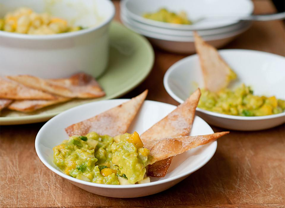 fruity guacamole on plates with chips