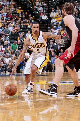 INDIANAPOLIS, IN - APRIL 9: George Hill #3 of the Indiana Pacers drives against Aaron Gray #34 of the Toronto Raptors on April 9, 2012 at Bankers Life Fieldhouse in Indianapolis, Indiana. (Photo by Ron Hoskins/NBAE via Getty Images)
