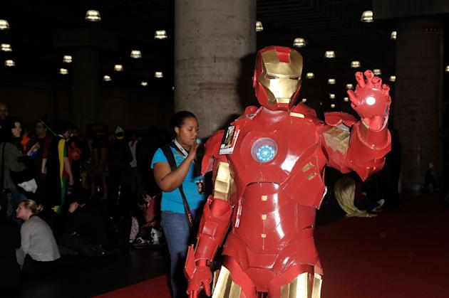 A Comic Con attendee wearing an Iron Man costume poses during the 2012 New York Comic Con. (Getty)