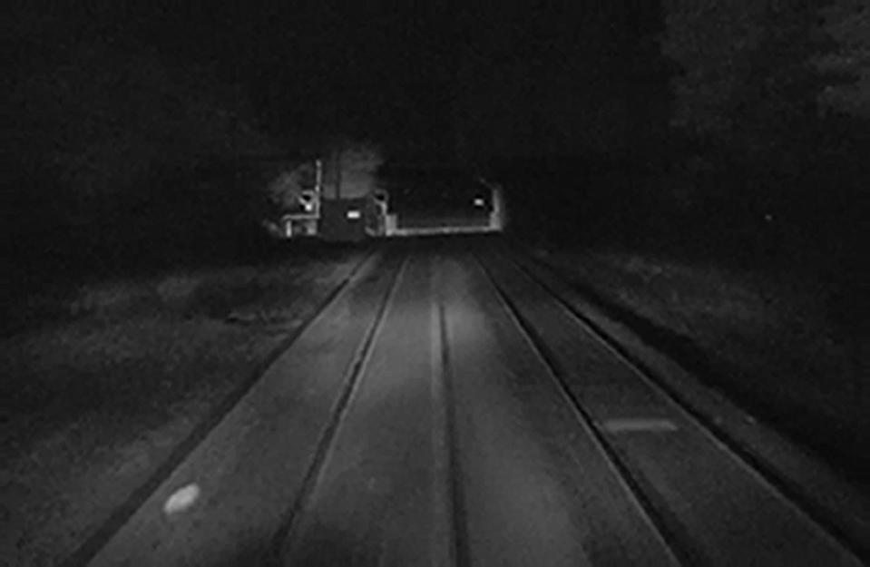 Undated handout CCTV grab of Norwich Road level crossing about four seconds before a train reached the crossing, narrowly avoiding a car that had driven over with raised barriers.