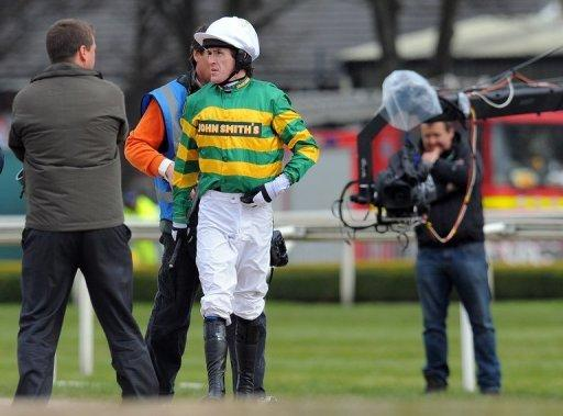 Jockey Tony McCoy waits as his mount Synchronised is returned to the start ahead of the Grand National horse race at Aintree Racecourse in Liverpool, on April 14. Synchronised and According to Pete were later both put down after falling at Becher's Brook, taking the total of fatalities at this year's three-day Aintree meeting to three