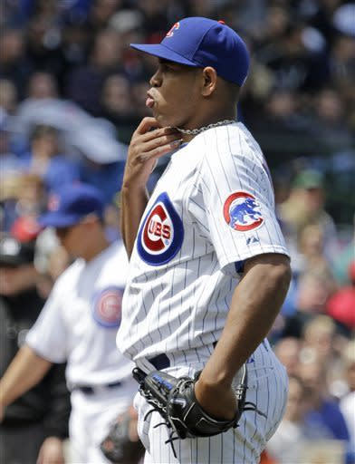 Chicago Cubs relief pitcher Carlos Marmol reacts reacts after he walked Cincinnati Reds' Joey Votto during the eighth inning of a baseball game in Chicago, Saturday, May 4, 2013. (AP Photo/Nam Y. Huh)