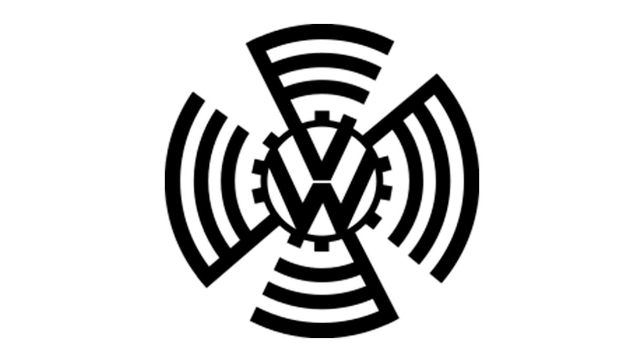 """<p>The first<a href=""""https://uk.motor1.com/volkswagen/"""">Volkswagen</a>logo reflects its birth as the """"people's car"""" that Adolf Hitler wanted to motorise the citizens of Nazi Germany.</p> <p>The initials of the words Volks and Wagen are arranged inside a circle, one above the other, and embedded in a cogwheel whose perimeter develops a graphic theme that is a reinterpretation of the swastika. The original design is from Reimspiess, who will then sign the Beetle engine design.</p><h2>Here's the new logo!</h2><ul><li><a href=""""https://uk.motor1.com/news/369762/volkswagen-new-logo-unveiled/?utm_campaign=yahoo-feed"""">Volkswagen unveils new logo to kick off electrified era</a></li><br></ul>"""