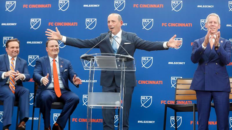 Major League Soccer commissioner Don Garber, center, officially announces the addition of FC Cincinnati as an expansion team, alongside Cincinnati Mayor John Cranley, left, FC Cincinnati general manager and president Jeff Berding, center left, and FC Cincinnati owner Carl Lindner III, right, Tuesday, May 29, 2018, at Rhinegeist Brewery in Cincinnati. (AP Photo/John Minchillo)