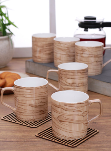 """<a href=""""https://fave.co/39NNkVv"""">BUY HERE</a> Beige printed bone china cups, from Myntra, for a discounted price of Rs. 607 (for a set of 6)"""