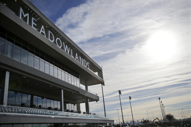 "FILE - In this Nov. 20, 2013, file photo, letters spell out Meadowlands over top the new grandstand at the race track in East Rutherford, N.J. The CEO of Meadowlands, Jeff Gural, has been among the leaders in harness racing in trying to curb doping. Meadowlands revealed that Tag Up and Go had tested positive for EPO in 2016. The Tag Up and Go doping case emerged through one of his initiatives, establishing ""out of competition"" drug testing, which means horses can be subject to testing at any time, on the track or off. (AP Photo/Mel Evans, File)"