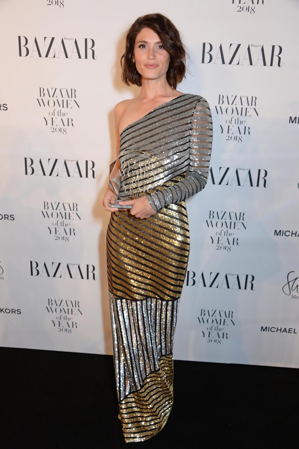 <p>Gemma accepted her award for Outstanding Performance wearing a one-shoulder metallic gown by Michael Kors. <em>[Photo: Getty]</em> </p>