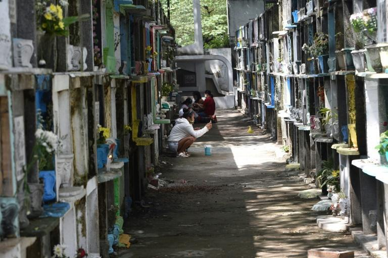 Filipinos pray at their dead relatives' resting places ahead of a week-long closure of cemeteries in Manila