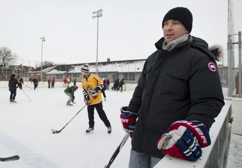 Montreal Canadiens' Josh Gorges keeps an eye on the play during a game of pick-up hockey in Montreal, Wednesday, Dec. 26, 2012. Gorges used Twitter to organize a Boxing Day outdoor hockey game with fans at a neighborhood rink in Montreal. (AP Photo/The Canadian Press, Graham Hughes)