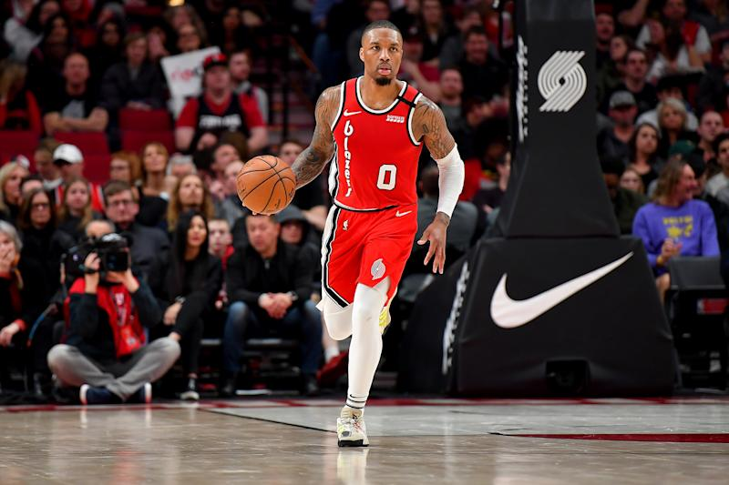 Damian Lillard dribbles the ball up the court.
