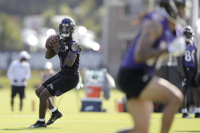 Baltimore Ravens quarterback Lamar Jackson works out during NFL football training camp, Thursday, July 25, 2019, in Owings Mills, Md. (AP Photo/Julio Cortez)