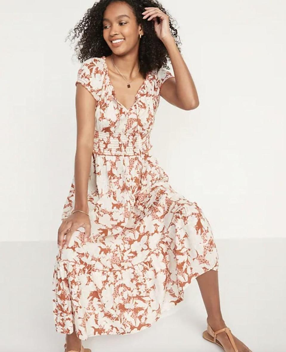 <p>We love how easy it will be to dress up this <span>Smocked Waist-Defined Floral-Print Midi Dress</span> ($45). With wraparound sandals and a pair of gorgeous earrings you can instantly elevate this piece.</p>