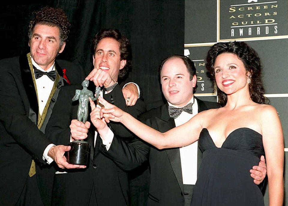 """""""Seinfeld"""" stars Michael Richards, Jerry Seinfeld, Jason Alexander and Julia Louis-Dreyfus celebrate their award for outstanding ensemble in a comedy series at the Screen Actors Guild Awards on Feb. 25, 1995, in Los Angeles. (Photo: Vince Bucci/AFP/Getty Images)"""