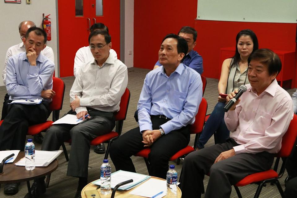 (L-R) Top SMRT officials Lee Ling Wee, Desmond Kuek and Seah Moon Ming, and Transport Minister Khaw Boon Wan at a media briefing on Monday, 17 October, 2017. PHOTO: Dhany Osman/Yahoo News Singapore