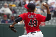 Cleveland Indians relief pitcher Emmanuel Clase delivers against the Detroit Tigers during the ninth inning of a baseball game in Cleveland, Sunday, April 11, 2021. Cleveland won 5-2. Eight games into a new season, the Indians, who began 2021 with questions about the back end of their bullpen, now seem to have found an answer in Clase, a harder-than-hard-throwing right-hander who came over in a 2019 trade from Texas and missed last season due to a drug suspension. (AP Photo/Phil Long)