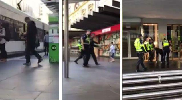 The man boards a tram with flowers in his hand, before being escorted off by police and made to return the boquet. Pictures: Joshua John Arnott