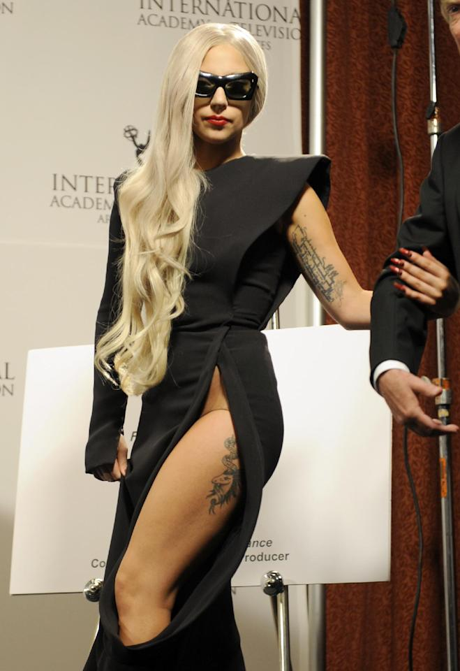 FILE - In this Nov. 21, 2011 file photo, Lady Gaga arrives in the press room at the International Emmy Awards in New York. Oprah Winfrey and U.S. Health and Human Services Secretary Kathleen Sebelius are among those scheduled to join Lady Gaga at Harvard University this month for the launch of the singer's Born This Way Foundation. The nonprofit is scheduled to be unveiled Feb. 29 at Harvard's Graduate School of Education before policy makers, foundation leaders and youth. (AP Photo/Henny Ray Abrams, file)
