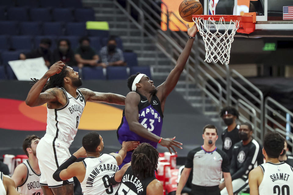 Toronto Raptors' Pascal Siakam (43) scores past Brooklyn Nets' DeAndre Jordan (6) during the second half of an NBA basketball game Wednesday, April 21, 2021, in Tampa, Fla. The Raptors won 114-103. (AP Photo/Mike Carlson)