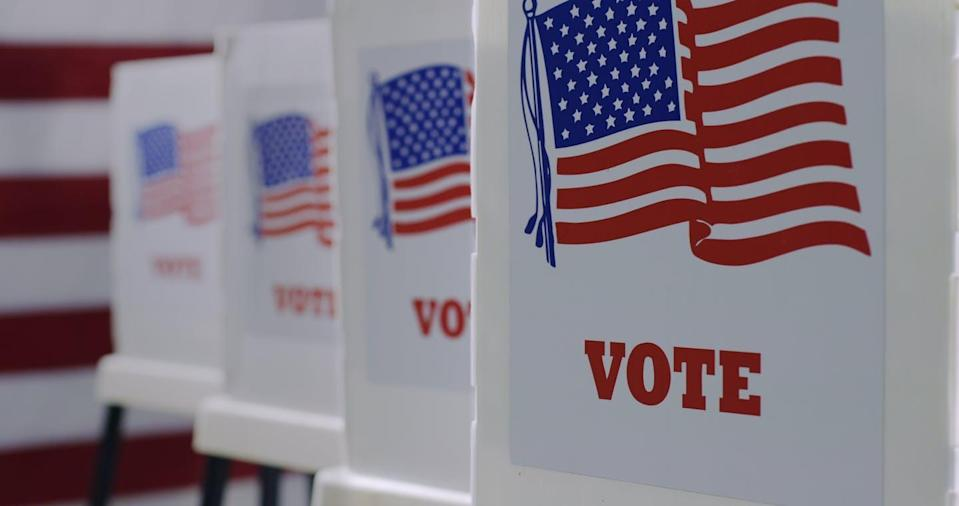"""<span class=""""attribution""""><a class=""""link rapid-noclick-resp"""" href=""""https://www.shutterstock.com/es/image-photo/straight-on-row-voting-booths-polling-1743370412"""" rel=""""nofollow noopener"""" target=""""_blank"""" data-ylk=""""slk:Shutterstock / vesperstock"""">Shutterstock / vesperstock</a></span>"""
