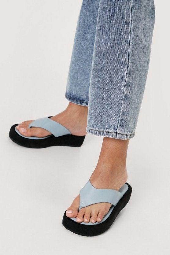 """<br><br><strong>NastyGal</strong> Faux Leather Toe Thong Flatform Sandals, $, available at <a href=""""https://go.skimresources.com/?id=30283X879131&url=https%3A%2F%2Fwww.nastygal.com%2Ffaux-leather-toe-thong-flatform-sandals%2FAGG07782.html%3Fcolor%3D106"""" rel=""""nofollow noopener"""" target=""""_blank"""" data-ylk=""""slk:NastyGal"""" class=""""link rapid-noclick-resp"""">NastyGal</a>"""