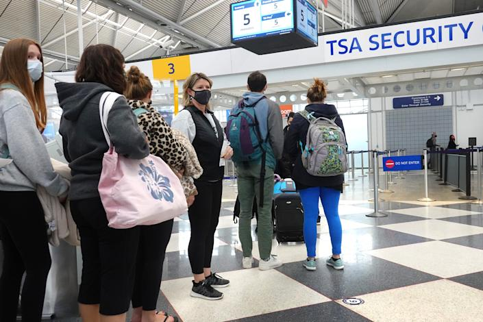 CHICAGO, ILLINOIS - MARCH 16: Travelers arrive for flights at O'Hare international Airport on March 16, 2021 in Chicago, Illinois. On March 12, the TSA screened more than 1.3 million travelers, the highest number since the start of the pandemic.  (Photo by Scott Olson/Getty Images)