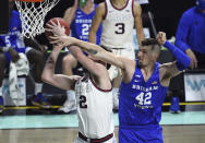 BYU center Richard Harward (42) defends against Gonzaga forward Drew Timme during the first half of an NCAA college basketball game for the West Coast Conference men's tournament championship Tuesday, March 9, 2021, in Las Vegas. (AP Photo/David Becker)