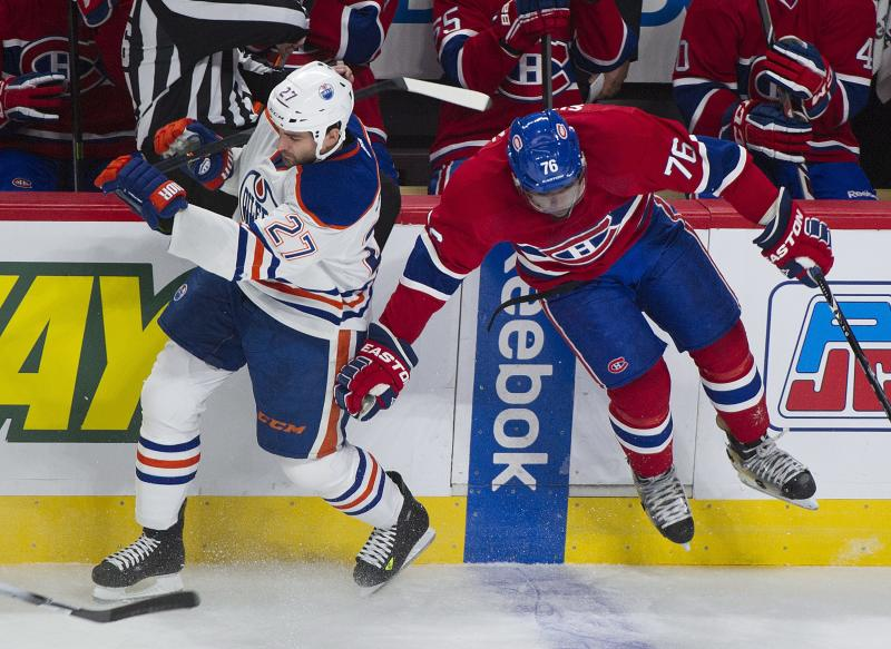Montreal Canadiens' P.K. Subban, right, collides with Edmonton Oilers' Boyd Gordon during the first period of an NHL hockey game in Montreal, Tuesday, Oct. 22, 2013. (AP Photo/The Canadian Press, Graham Hughes)