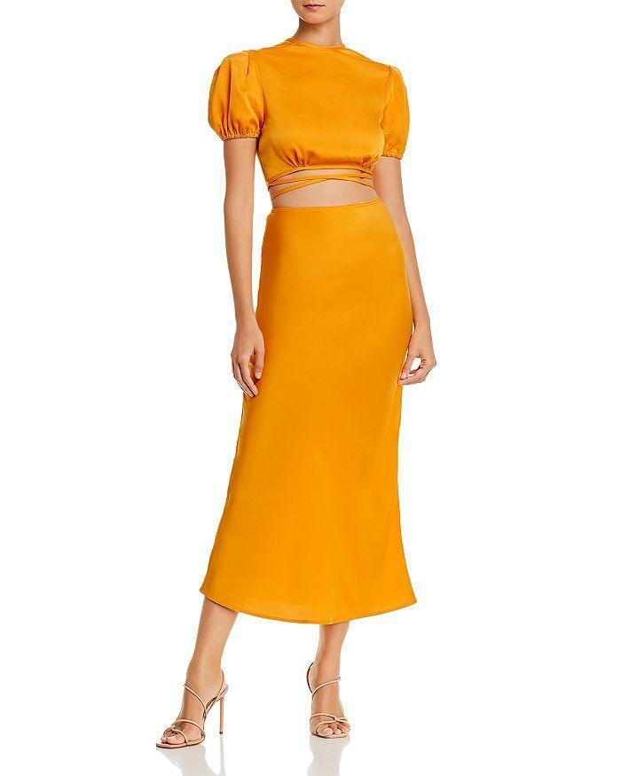 """<p><strong>WAYF</strong></p><p>bloomingdales.com</p><p><strong>$40.95</strong></p><p><a href=""""https://go.redirectingat.com?id=74968X1596630&url=https%3A%2F%2Fwww.bloomingdales.com%2Fshop%2Fproduct%2Fwayf-kati-cropped-tie-back-top-jaden-bias-midi-skirt%3FID%3D3695543&sref=https%3A%2F%2Fwww.cosmopolitan.com%2Fstyle-beauty%2Ffashion%2Fg10327302%2Fcute-fall-outfits%2F"""" rel=""""nofollow noopener"""" target=""""_blank"""" data-ylk=""""slk:Shop Now"""" class=""""link rapid-noclick-resp"""">Shop Now</a></p><p>You'll be seeing a LOT of this gorge color come fall. Whether you want to wear this skirt with the matching top or a neutral tee, you'll be right on trend. </p>"""