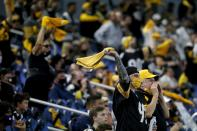 Pittsburgh Steelers fans cheer on their team late in the second half of an NFL football game against the Dallas Cowboys in Arlington, Texas, Sunday, Nov. 8, 2020. (AP Photo/Michael Ainsworth)