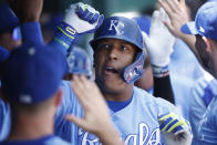 Kansas City Royals' Salvador Perez celebrates in the dugout following his two-run home run during the first inning of a baseball game at Kauffman Stadium in Kansas City, Mo., Thursday, July 29, 2021. (AP Photo/Colin E. Braley)