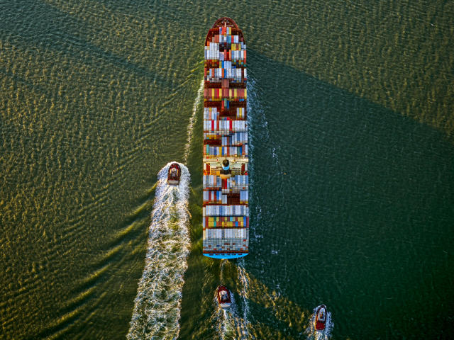 <p>Container ship and tugs. (© Jeffrey Milstein and courtesy Benrubi Gallery) </p>