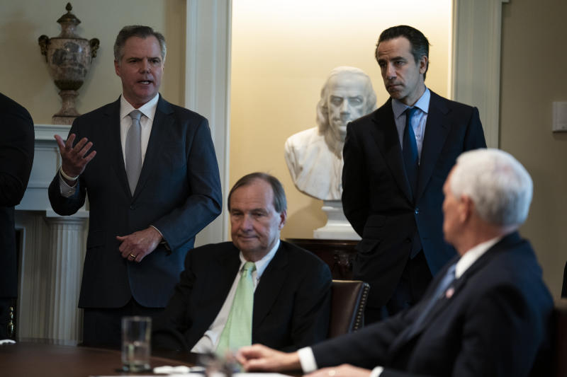 James Murren, President & CEO of MGM, speaks during a meeting with President Donald Trump and tourism industry executives about the coronavirus, in the Cabinet Room of the White House, Tuesday, March 17, 2020, in Washington. From left, Murren, Richard Bates, EVP, Disney, Chip Rogers, President & CEO, American Hotel & Lodging Association, and Vice President Mike Pence. (AP Photo/Evan Vucci)
