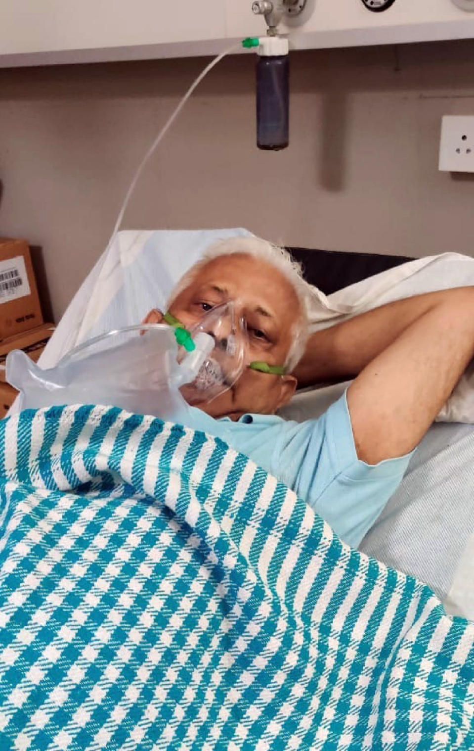 In this photo provided by the Rev. Cedric Prakash, the Rev. Jerry Sequeira is given oxygen in Ahmedabad, India, during the country's second wave of the coronavirus pandemic. Sequeira died from COVID-19 on April 18, 2021. (Cedric Prakash via AP)