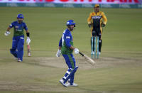 Multan Sultans' James Vince, center, follows the ball after playing a shot for boundary during a Pakistan Super League T20 cricket match between Multan Sultans and Peshawar Zalmi at the National Stadium, in Karachi, Pakistan, Tuesday, Feb. 23, 2021. (AP Photo/Fareed Khan),